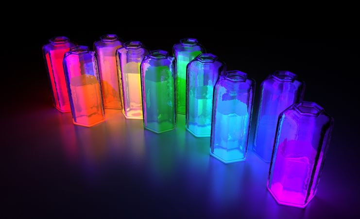 a row of brightly glowing ink bottles in various colors