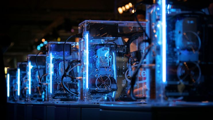 a row open computer cases with blue fans and lights